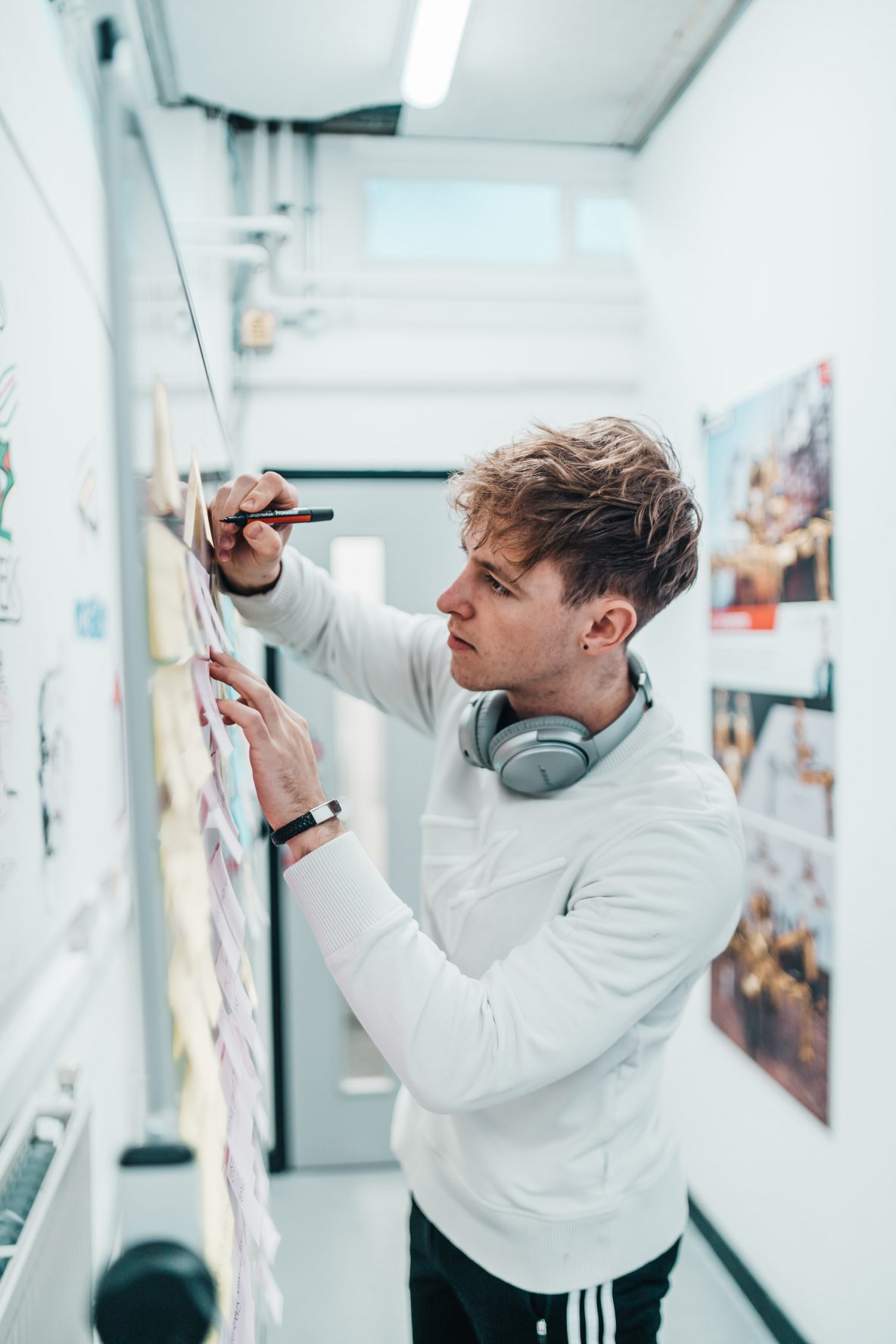 younger man on whiteboard